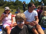 Face painted family at picnic